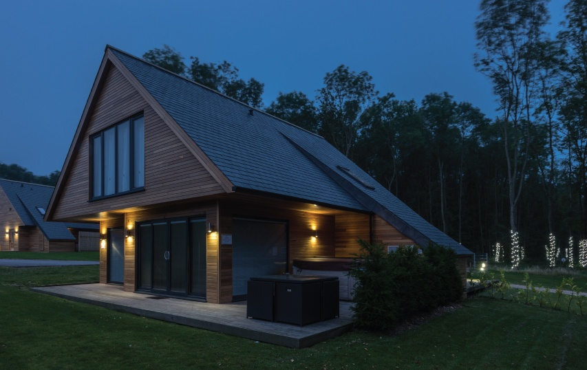 country lodges uk with a big pitched roof