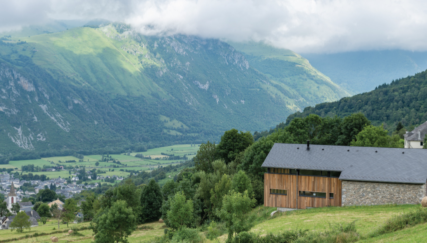 house in french pyrenees with a slate roof