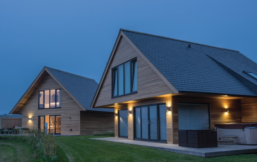 a moderm house with slate and wood combination