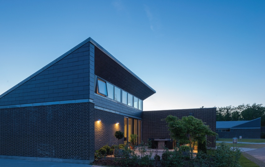 private home in denmark with slopped slate roof