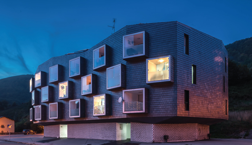 mining housing in Spain with slate cladding
