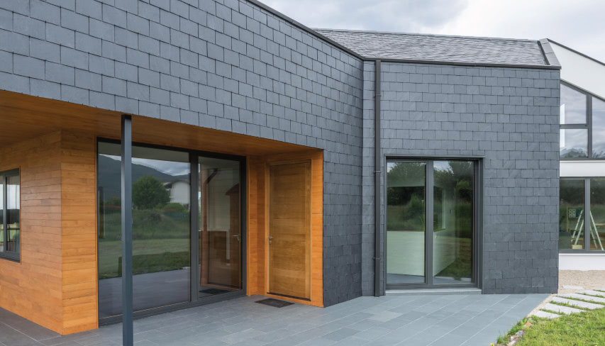 bioclimatic house with a slate facade in Spain