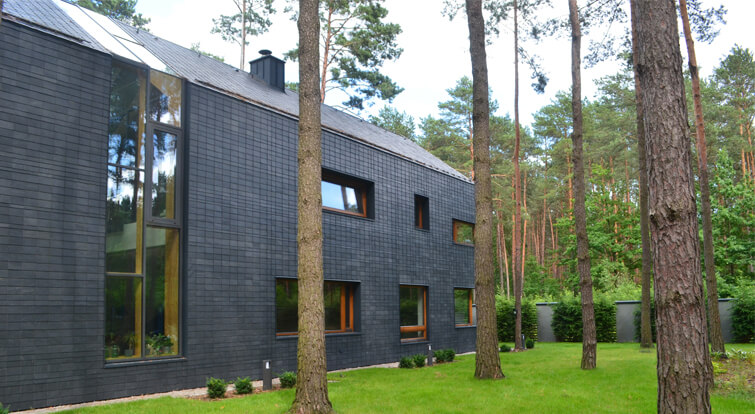 modern house designed with slate, wood and large windows