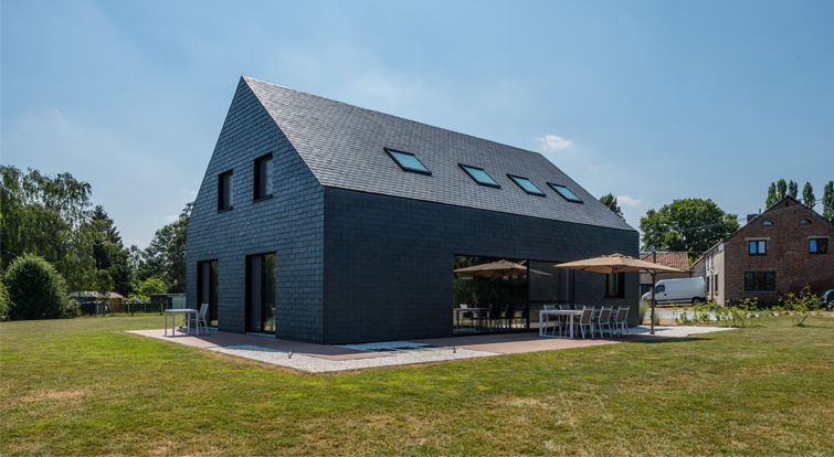 impressive house with slate ventilated façades and pitched roof