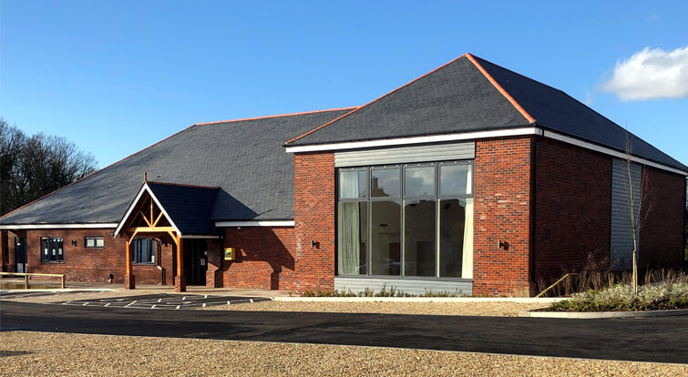 New village hall in Thakeham, slate pitched roof