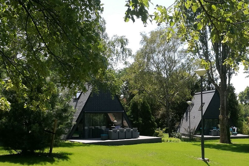 triangular houses with slate cladding and roof in Hungary