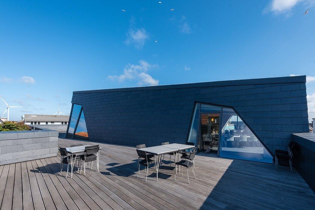 bâtiment habillé d'ardoise avec CUPACLAD au Danemark